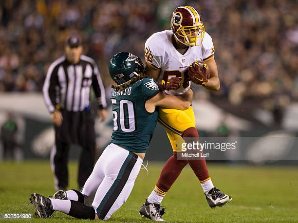 Kiko Alonso of the Philadelphia Eagles tackles Jordan Reed of the Washington Redskins on December 26 2015 at Lincoln Financial Field in Philadelphia...