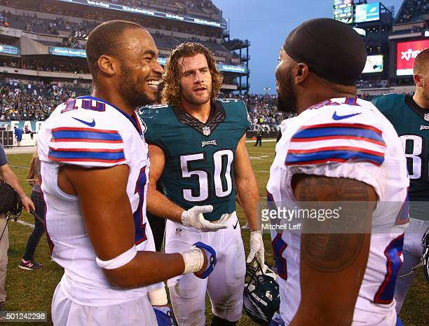 Kiko Alonso of the Philadelphia Eagles talks to Robert Woods and Duke Williams of the Buffalo Bills after the game on December 13 2015 at the Lincoln...