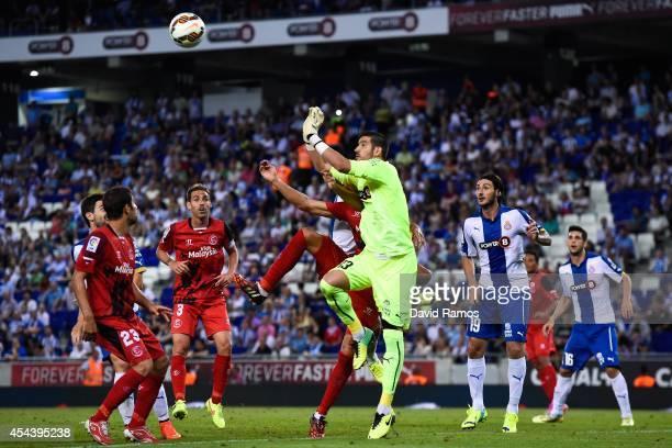 Kiko Casilla of RCD Espanyol clears a high ball during the La Liga Match between RCD Espanyol and Sevilla FC at CornellaEl Prat Stadium on August 30...