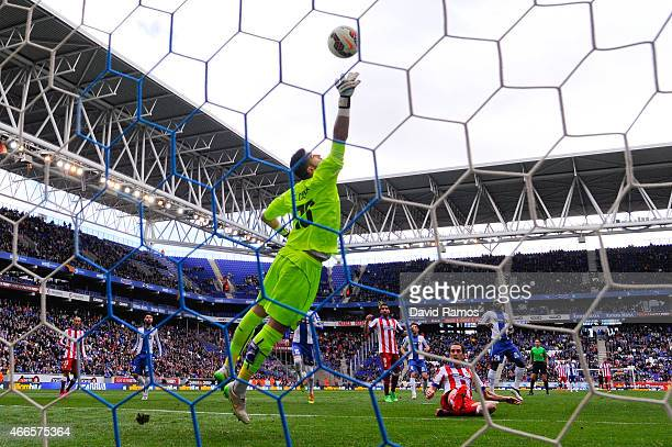 Kiko Casilla of RCD Espanyol dives for the ball during the La Liga match between RCD Espanyol and Club Atletico de Madrid at Power 8 Stadium on March...