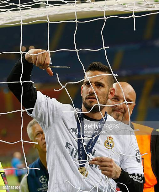 Kiko Casilla of Real Madrid cuts the goal net while celebrating victory after winning the Champions League final match between Real Madrid and Club...