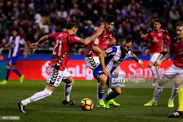 Kiko Femenia defender of Deportivo Alaves battles for the ball with Emre Çolak midfielder of Deportivo de La Coruña during the La Liga Santander...