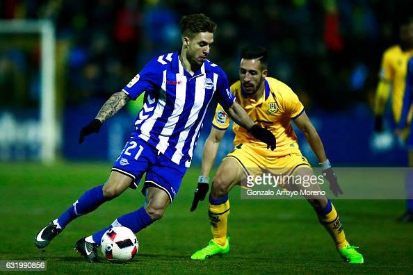 Kiko Femenia of Deportivo Alaves competes for the ball with Daniel Toribio of Agrupacion Deportivo Alcorcon during the Copa del Rey quarterfinal...