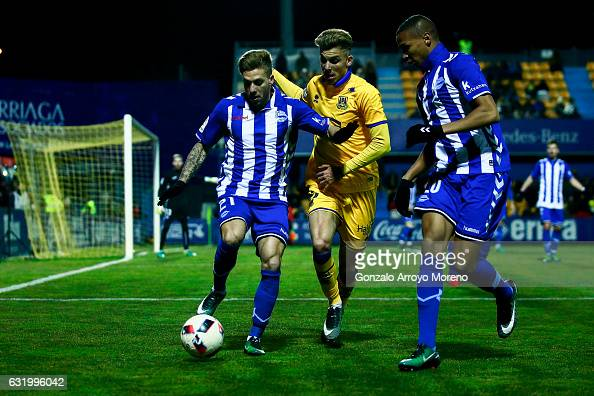 Kiko Femenia of Deportivo Alaves competes for the ball with Ivan Alejo of Agrupacion Deportivo Alcorcon during the Copa del Rey quarterfinal match...