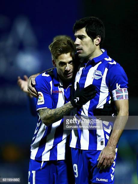 Kiko Femenia of Deportivo Alaves hugs his teammate Manuel Garcia Sanchez after winnig the Copa del Rey quarterfinal match between Agrupacion...