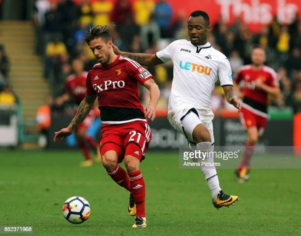 Kiko Femenia of Watford challenged by Jordan Ayew of Swansea City during the Premier League match between Swansea City and Watford at The Liberty...