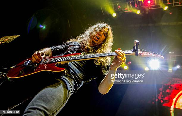 Kiko Loureiro performs during Megadeth concert as part of Dystopia World Tour at Luna Park on August 22 2016 in Buenos Aires Argentina