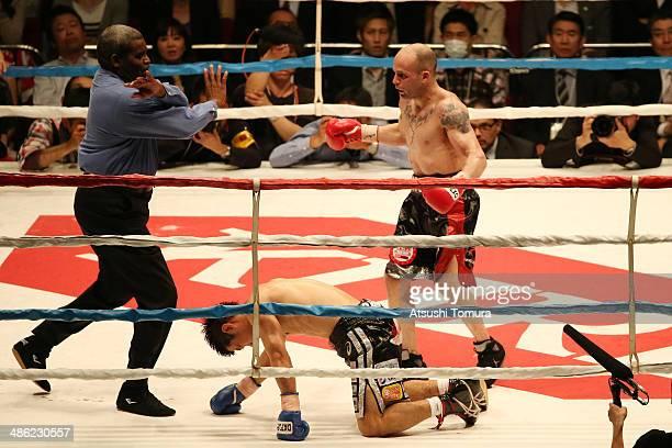 Kiko Martinez of Spain knocks down Hozumi Hasegawa of Japan during the IBF super bantamweight title bout between Kiko Martinez of Spain and Hozumi...