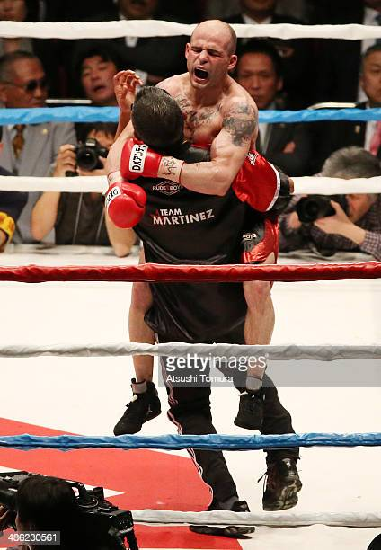 Kiko Martinez Spain celebrates after victory over Hozumi Hasegawa of Japan to defend his title during the IBF super bantamweight title bout between...