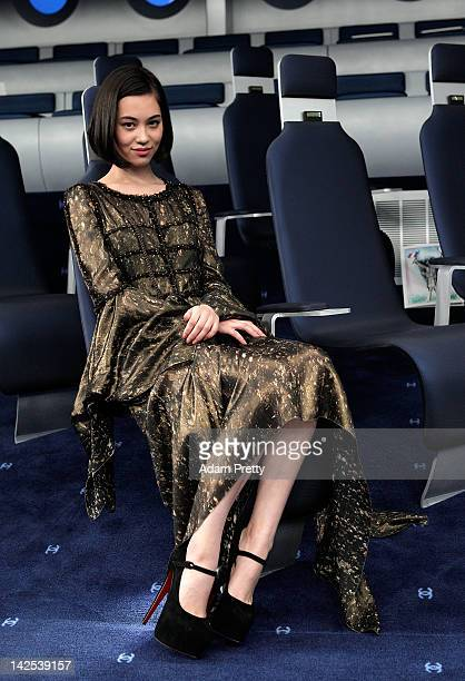 Kiko Mizuhara poses for photographs during the Chanel 2012 Spring/Summer Haute Couture Collection Show at Shinjuku Gyoen Park on March 22 2012 in...