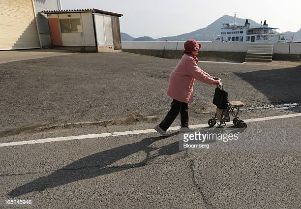 Kiku Sakakibara pushes a stroller as she takes a walk on Gogo Island in Matsuyama Ehime Prefecture Japan on Friday March 22 2013 A combination of the...