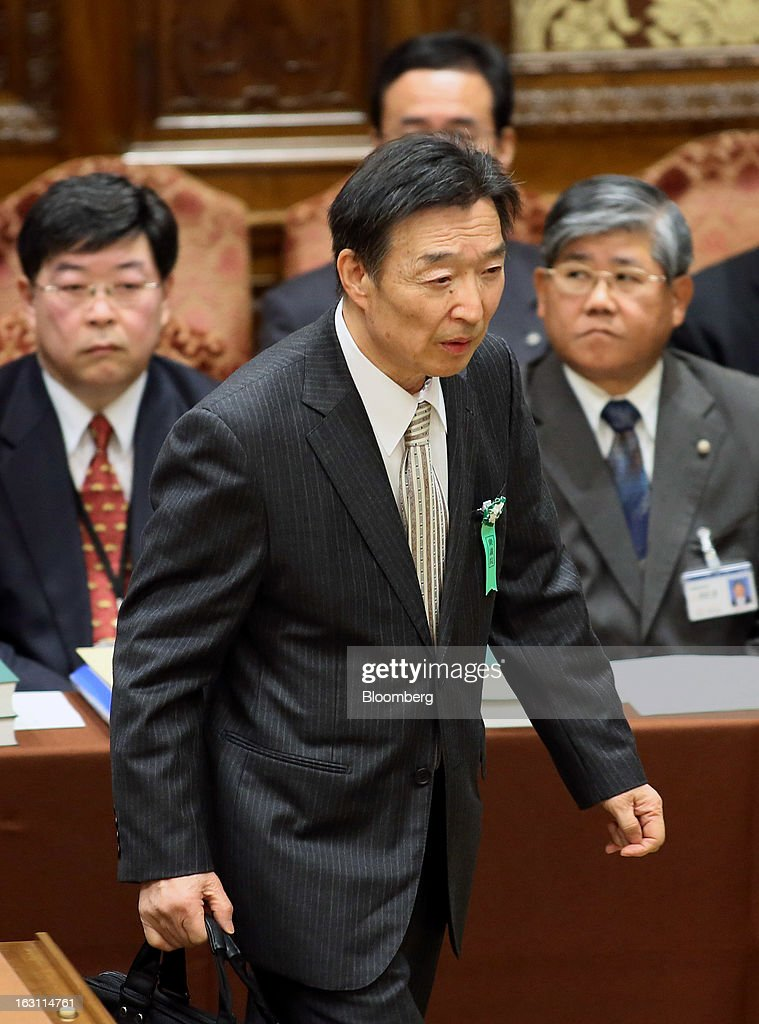 Kikuo Iwata, professor of economics at Gakushuin University and nominee for deputy governor of the Bank of Japan (BOJ), arrives for a confirmation hearing at the lower house of Parliament in Tokyo, Japan, on Tuesday, March 5, 2013. The Bank of Japan should buy longer-term bonds to help it achieve a 2 percent inflation target, said Iwata. Photographer: Haruyoshi Yamaguchi/Bloomberg via Getty Images