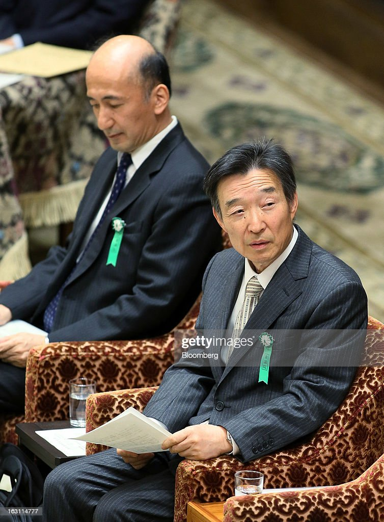 Kikuo Iwata, professor of economics at Gakushuin University and nominee for deputy governor of the Bank of Japan (BOJ), right, and Hiroshi Nakaso, assistant governor and executive director of the BOJ and nominee for second deputy governor of the BOJ, attend a confirmation hearing at the lower house of Parliament in Tokyo, Japan, on Tuesday, March 5, 2013. The Bank of Japan should buy longer-term bonds to help it achieve a 2 percent inflation target, said Iwata. Photographer: Haruyoshi Yamaguchi/Bloomberg via Getty Images