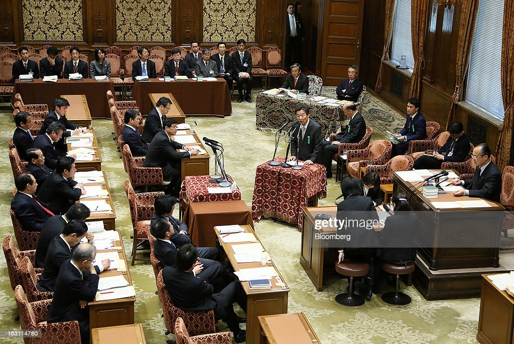 Kikuo Iwata, professor of economics at Gakushuin University and nominee for deputy governor of the Bank of Japan (BOJ), center standing, speaks during a confirmation hearing at the lower house of Parliament in Tokyo, Japan, on Tuesday, March 5, 2013. The Bank of Japan should buy longer-term bonds to help it achieve a 2 percent inflation target, said Iwata. Photographer: Haruyoshi Yamaguchi/Bloomberg via Getty Images