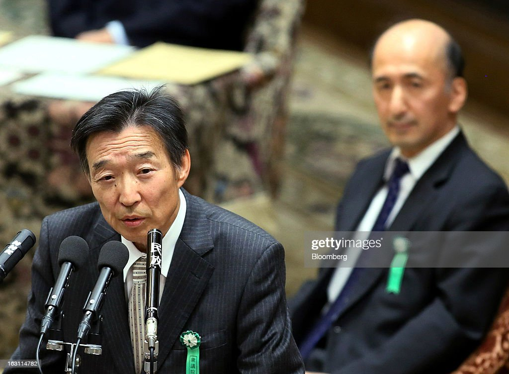 Kikuo Iwata, professor of economics at Gakushuin University and nominee for deputy governor of the Bank of Japan (BOJ), left, speaks as Hiroshi Nakaso, assistant governor and executive director of the BOJ and nominee for second deputy governor of the BOJ, looks on during a confirmation hearing at the lower house of Parliament in Tokyo, Japan, on Tuesday, March 5, 2013. The Bank of Japan should buy longer-term bonds to help it achieve a 2 percent inflation target, said Iwata. Photographer: Haruyoshi Yamaguchi/Bloomberg via Getty Images