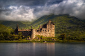 Kilchurn Castle reflections in morning light,, Highlands, Scotland