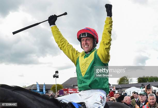 Kildare Ireland 26 April 2017 Robbie Power celebrates after winning the Coral Punchestown Gold Cup on Sizing John at Punchestown Racecourse in Naas...