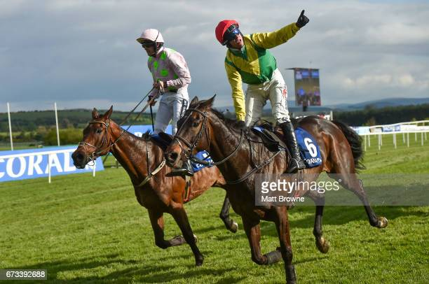 Kildare Ireland 26 April 2017 Robbie Power on Sizing John celebrates winning the Coral Punchestown Gold Cup ahead of second place Djakadam with Ruby...
