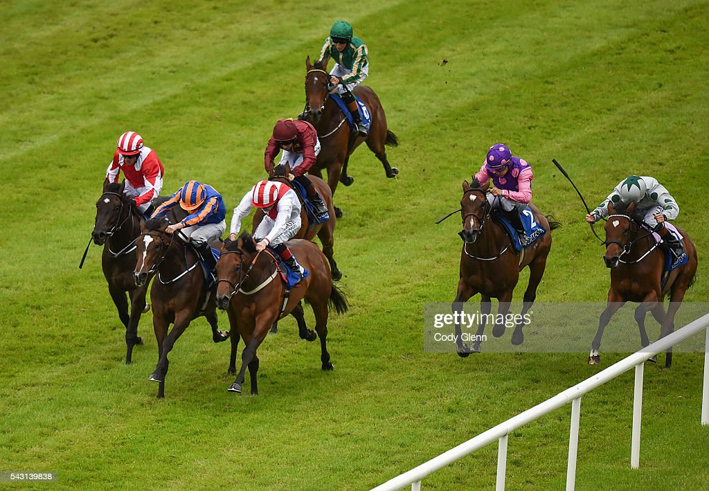 Kildare , Ireland - 26 June 2016; Eventual winner Roly Poly, second from left, with <a gi-track='captionPersonalityLinkClicked' href=/galleries/search?phrase=Ryan+Moore+-+Jockey&family=editorial&specificpeople=11563713 ng-click='$event.stopPropagation()'>Ryan Moore</a> up, races ahead of the field on their way to winning the Grangecon Stud Stakess at the Curragh Racecourse in the Curragh, Co. Kildare.