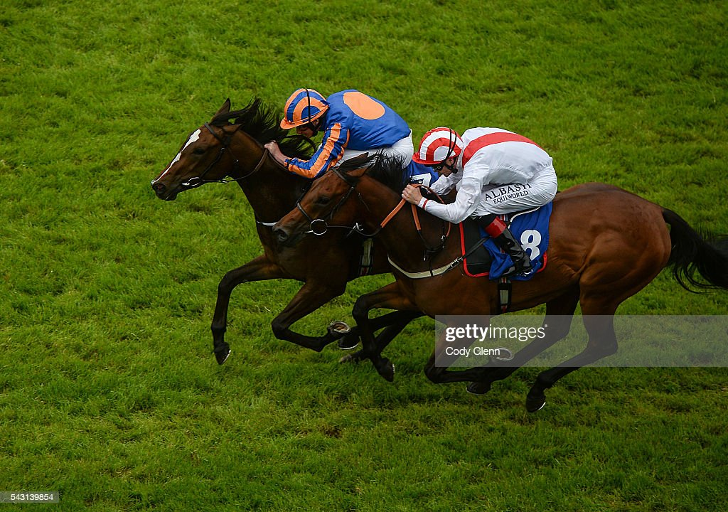 Kildare , Ireland - 26 June 2016; Eventual winner Roly Poly, with <a gi-track='captionPersonalityLinkClicked' href=/galleries/search?phrase=Ryan+Moore+-+Jockey&family=editorial&specificpeople=11563713 ng-click='$event.stopPropagation()'>Ryan Moore</a> up, races ahead of Seafront, with <a gi-track='captionPersonalityLinkClicked' href=/galleries/search?phrase=Pat+Smullen&family=editorial&specificpeople=607635 ng-click='$event.stopPropagation()'>Pat Smullen</a> up, on their way to winning the Grangecon Stud Stakess at the Curragh Racecourse in the Curragh, Co. Kildare.