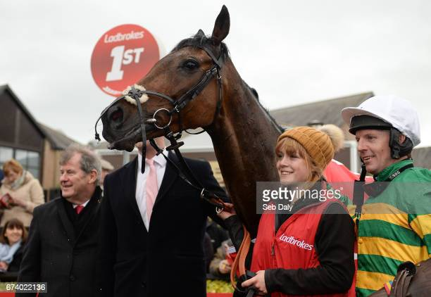 Kildare Ireland 27 April 2017 Jockey Noel Fehily right with the winning connections and horse Unowhatimeanharry after winning the Ladbrokes Champion...