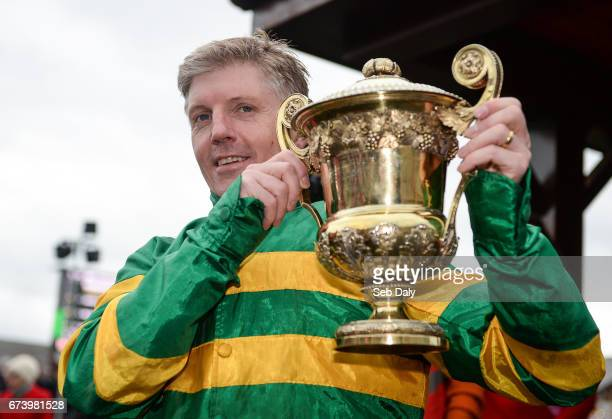 Kildare Ireland 27 April 2017 Noel Fehily holds the trophy after winning the Ladbrokes Champion Stayers Hurdle on Unowhatimeanharry at Punchestown...