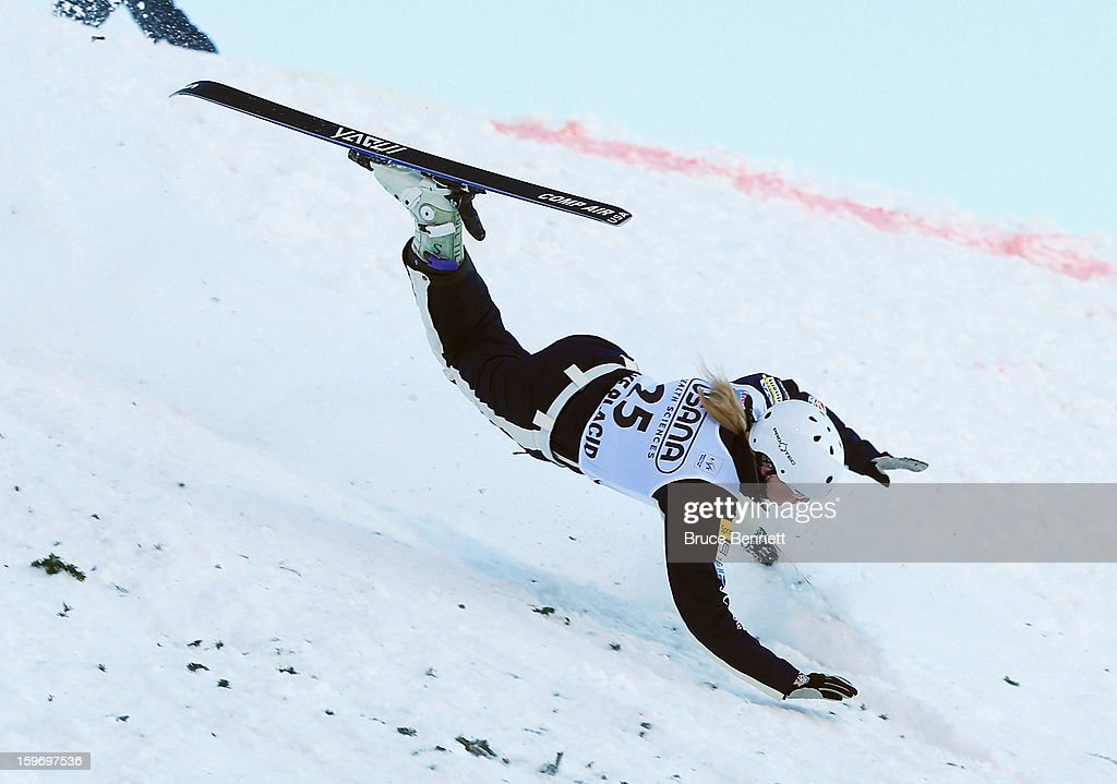 Kiley McKinnon #25 of the USA takes a spill in the qualification round of the USANA Freestyle World Cup aerial competition at the Lake Placid Olympic Jumping Complex on January 18, 2013 in Lake Placid, New York.
