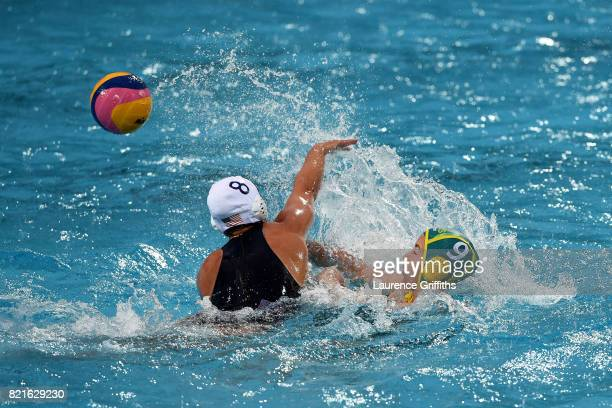 Kiley Neushul of The United States attempts to tackle of Zoe Arancini Australia during the Women's Water Polo Quarter final on day eleven of the...