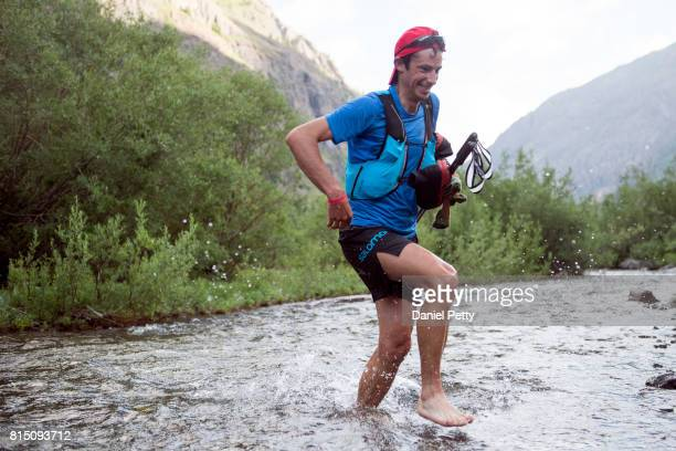 Kilian Jornet crosses Cunningham Creek during the Hardrock 100 endurance run through the San Juan Mountains on July 14 near Silverton Colorado The...