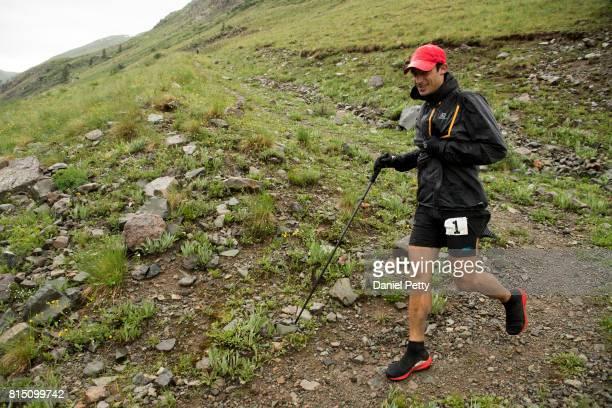 Kilian Jornet descends into the Grouse Gulch aid station during the Hardrock 100 endurance run through the San Juan Mountains on July 14 near...