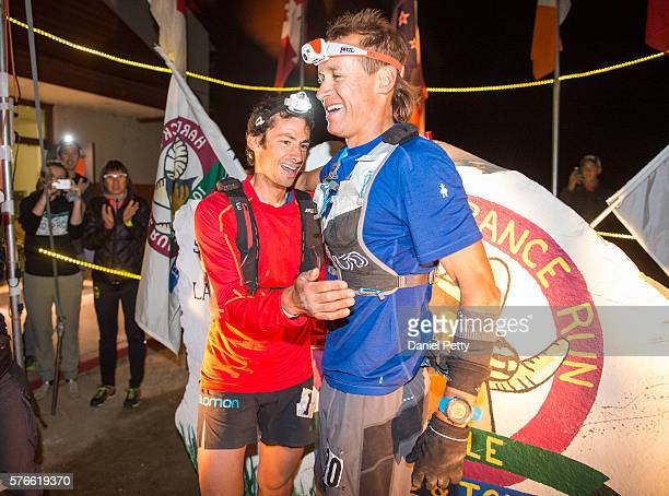 Kilian Jornet embraces Jason Schlarb of Durango after the finished together at the Hardrock 100 ultra distance run through the San Juan Mountains on...