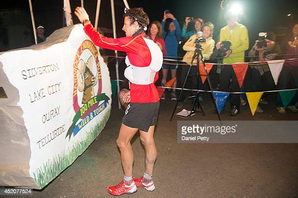 Kilian Jornet prepares to kiss the hard rock at the finish line signaling the end of the 1005mile Hardrock 100 Endurance Run on July 12 in the San...