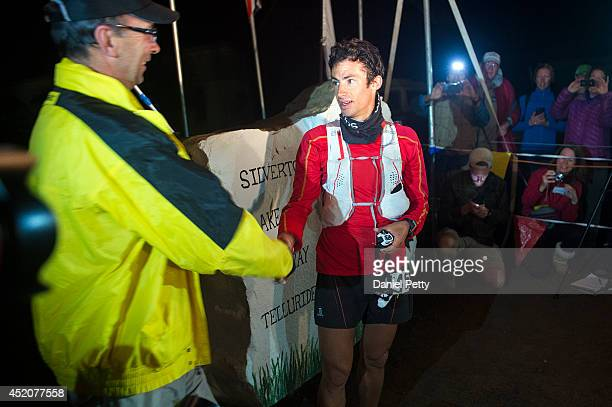 Kilian Jornet right shakes hands with run director Dale Garland left after he finished the 1005mile Hardrock 100 Endurance Run on July 12 in the San...