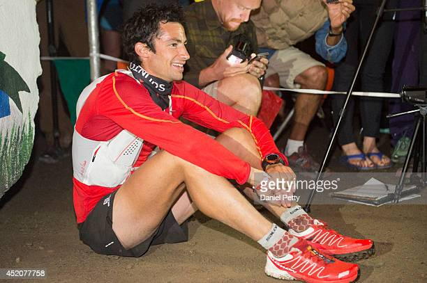 Kilian Jornet sits down on the ground after finishing the 1005mile Hardrock 100 Endurance Run on July 12 in the San Juan Mountains in Silverton...