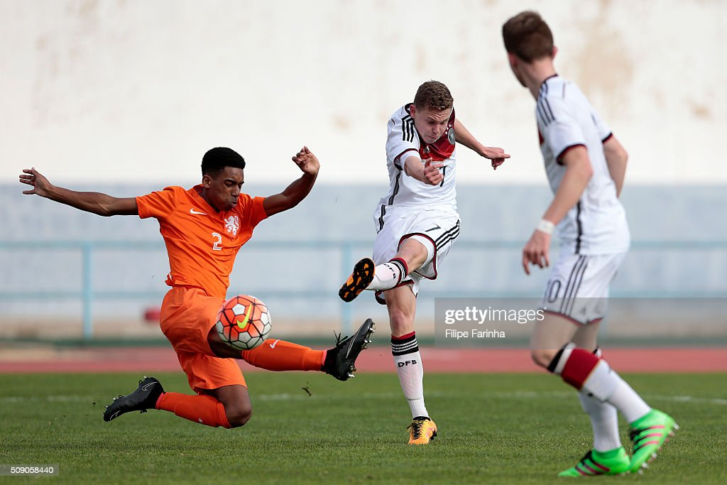 Kilian Ludewig of Germany challenges Robin Lathouwers of Netherlands during the UEFA Under16 match between U16 Germany v U16 Netherlands on February 8, 2016 in Vila Real de Santo Antonio, Portugal. (Photo by Filipe Farinha/Bongarts/Getty Images