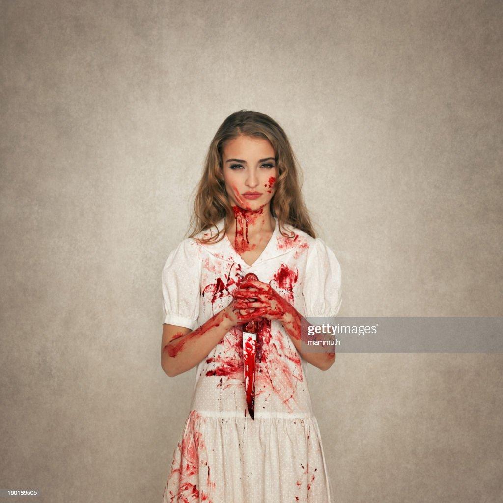 killer beauty holding bloody knife : Stock Photo