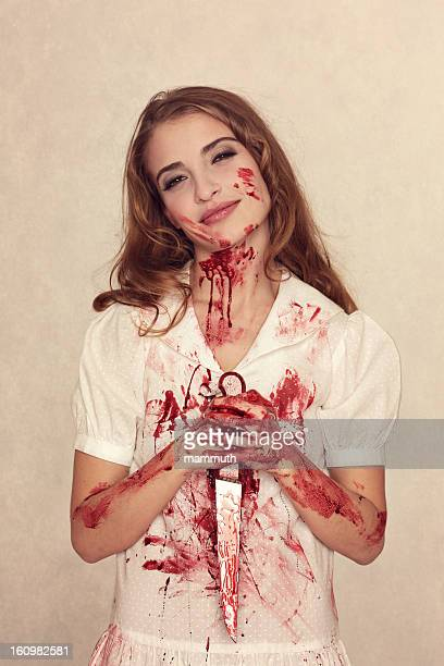 killer beauty holding bloody knife