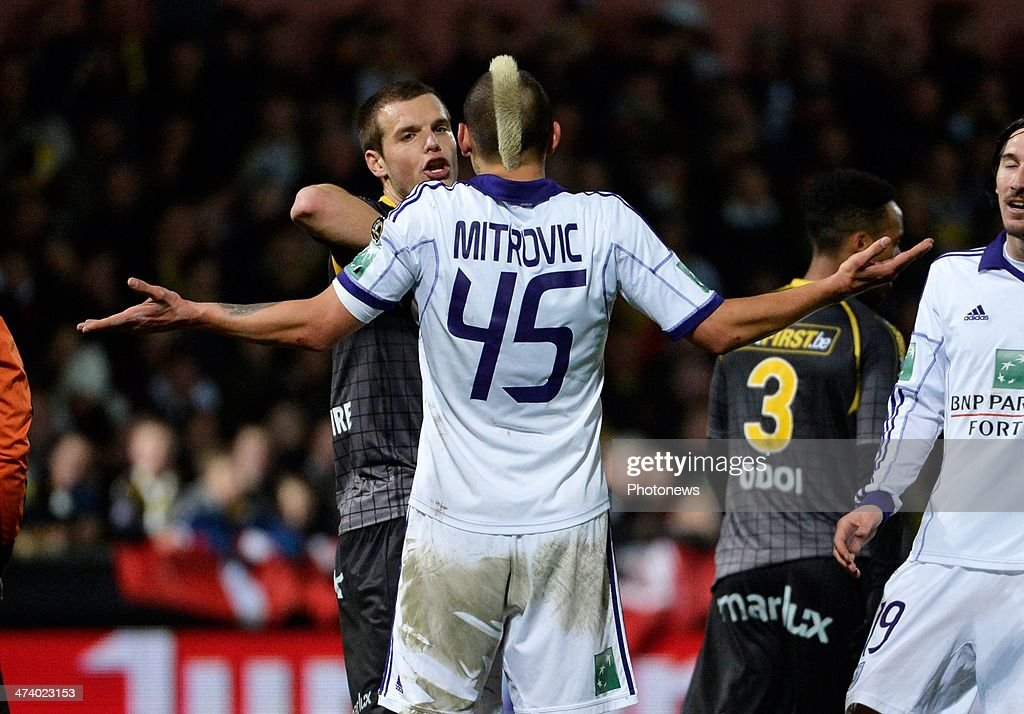 Killian Overmeire of Sporting Lokeren tussles with Aleksandar Mitrovic of RSC Anderlecht during the Jupiler League match between Sporting Club Lokeren Oost-Vlaanderen and RSC Anderlecht on February 21, 2014 in Lokeren, Belgium.