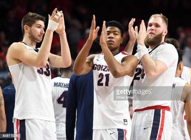 Killian Tillie Rui Hachimura and Przemek Karnowski of the Gonzaga Bulldogs celebrate on the court after defeating the Pacific Tigers 8250 in a...