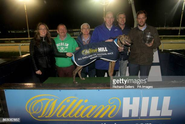 Killieford Banjo with owners N S Black and Mr N S Black after winning the first race at Newcastle during the William Hill All England Cup Festival at...