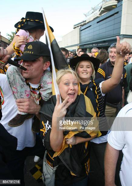 Killkenny fans cheer after their team beat Waterford to win three All Ireland hurling championships in a Row outside Croke Park Dublin