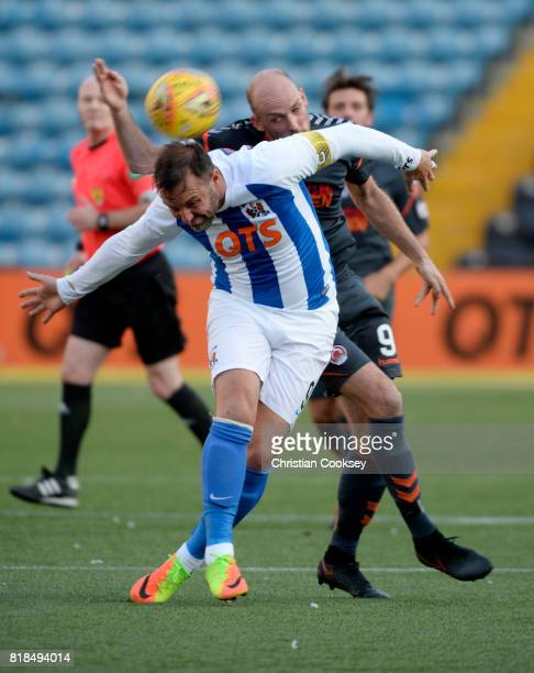 Kilmarnock captain Kris Boyd battles to get away from Clyde's Kevin Nicol during the Betfred League Cup game on July 18 2017 in Kilmarnock Scotland