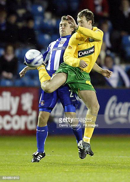 Kilmarnock's James Fowler and Celtic's Aiden McGeady during the CIS Insurance Cup match at Rugby Park Kilmarnock