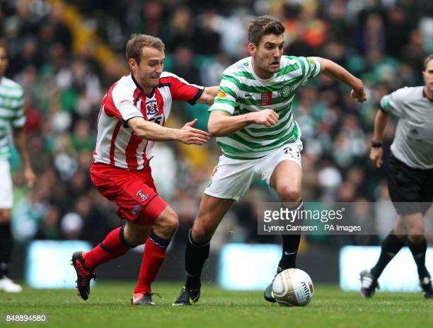 Kilmarnock's Liam Kelly and Celtic's Charlie Mulgrew battle for the ball during the Clydesdale Bank Premier League match at Celtic Park Glasgow