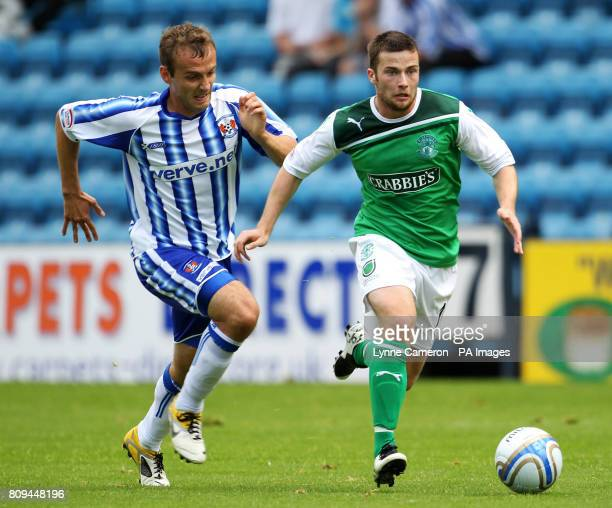 Kilmarnock's Liam Kelly and Hibernian's Matthew Thornhill during the Clydesdale Bank Scottish Premier League match at Rugby Park Kilmarnock