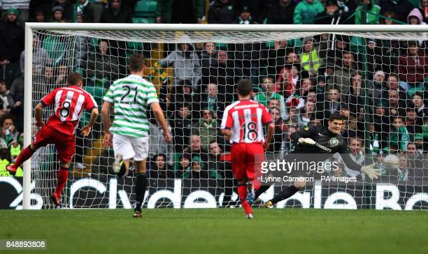 Kilmarnock's Liam Kelly scores a penalty past Celtic's Fraser Forster during the Clydesdale Bank Premier League match at Celtic Park Glasgow