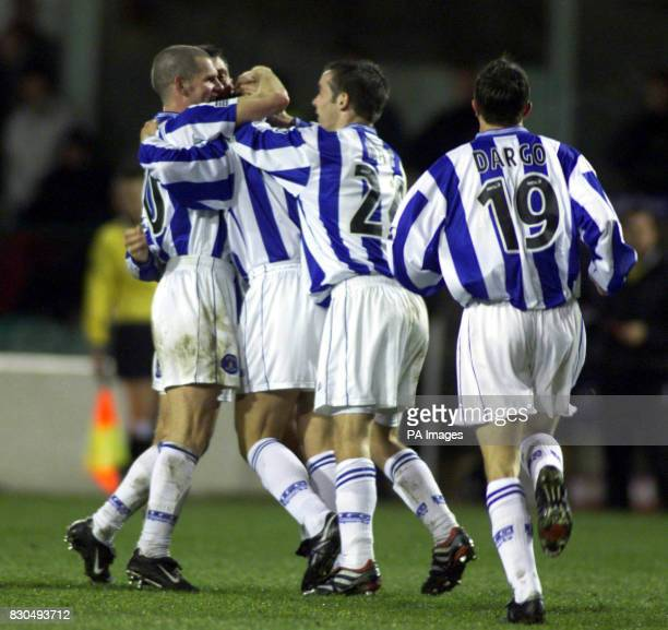 Kilmarnock's paul Wright is mobbed by teammates after his equalizer against Hibernin in their Scottish Premier League match at Hibernian's Easter...