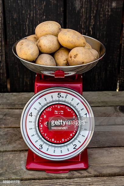 Kilogram of potatoes on a kitchen scale