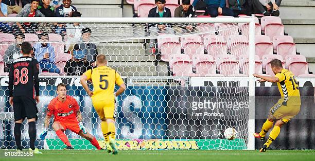 Kim Aabech of AC Horsens scores the 10 goal against Goalkeeper Johan Dahlin of FC Midtjylland during the Danish Alka Superliga match between FC...