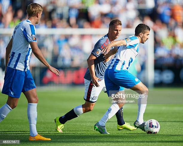 Kim Aabech of AGF Arhus and Mohamed El Makrini of OB Odense compete for the ball during the Danish Alka Superliga match between OB Odense and AGF...
